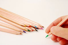 Ready to write. Human hand ready to write with color pencils stock photos
