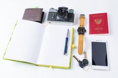 Ready for travel isolated objects. Phone, watches, keys, notebook, passport, photo camera, purse on white background. royalty free stock image