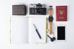 Ready for travel isolated objects. Phone, watches, keys, notebook, passport, photo camera, purse on white background. stock images