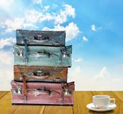 Ready for travel in morning concept, Old travel bag and coffee cup Stock Photo