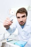 Ready for treatment. Dentist is ready for treatment of carious teeth Royalty Free Stock Photo