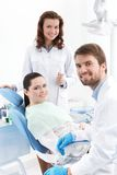 Ready for treatment of carious teeth. Dentist, assistant and the patient are ready for treating carious teeth Royalty Free Stock Photos