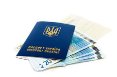 Ready for vacation. One  blue Ukrainian passport with some euro bills and tickets isolated on white Stock Photos