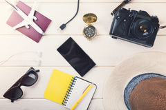Ready for vacations - travel essentials on white wooden backgrou Royalty Free Stock Images
