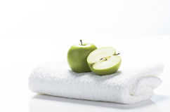 Ready for wellbeing. Fitness equipment towel, apples against a white background Stock Images
