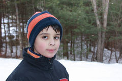 Ready for Winter. Very expressive boy wearing jacket and hat smiling happily during winter time Stock Photography