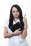 Ready for work. Good looking woman holding a filofax ready for a hard days work Royalty Free Stock Image