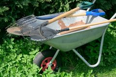 Ready for work. Wheelbarrow and garden tools Stock Image