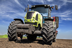 Ready for work. Tractor is prepared and ready for work. Preparing field for sowing Royalty Free Stock Images