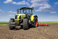 Ready for work. Tractor is prepared and ready for work. Preparing field for sowing Stock Photo
