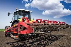 Ready for work. Tractor is prepared and ready for work. Preparing field for sowing Stock Photos