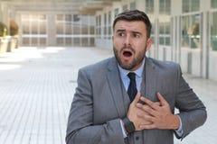 Reagera för affärsman som är dramatiskt i kontoret royaltyfria foton