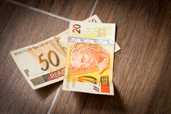 20 and 50 Reais on the floor (Brazilian Money) Stock Image