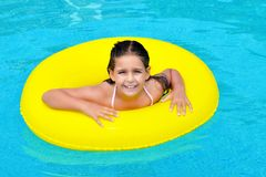 Real adorable girl relaxing in swimming pool Royalty Free Stock Photos