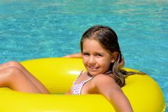 Real adorable girl relaxing in swimming pool Royalty Free Stock Images