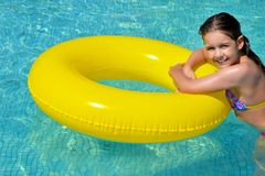 Real adorable girl relaxing in swimming pool Royalty Free Stock Image