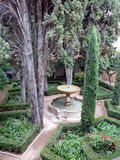 Real Alcazar Gardens in Seville Spain. Real Alcazar Gardens, decorated with fountains and trees , in Seville Spain Stock Image