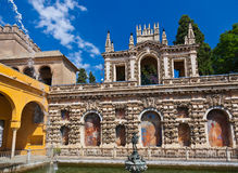 Real Alcazar Gardens in Seville Spain. Nature and architecture background Royalty Free Stock Photos