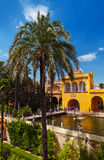 Real Alcazar Gardens in Seville Spain. Nature and architecture background Stock Photos