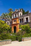 Real Alcazar Gardens in Seville Spain. Nature and architecture background Royalty Free Stock Photo