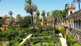 Real Alcazar Gardens in Seville Spain. Nature and architecture background Royalty Free Stock Image