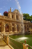 Real Alcazar Seville Spain. Splash on Sunny day real alcazar Stock Photo