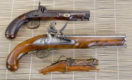 Three Real Antique Pistols. stock images