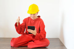 Real architect holding tablet while planing house renovation Stock Photos