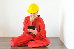 Real architect holding tablet while planing house renovation Royalty Free Stock Image