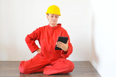 Real architect holding tablet while planing house renovation Royalty Free Stock Images