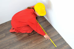 Real architect taking measures in home Stock Images