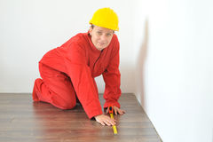 Real architect taking measures in home Stock Photo