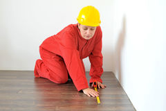Real architect taking measures in home Royalty Free Stock Photography