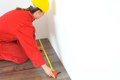Real architect taking measures while planing house renovation Royalty Free Stock Images