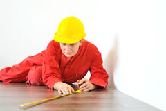 Real architect taking measures while planing house renovation Royalty Free Stock Photo