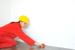 Real architect taking measures while planing house renovation Stock Photo