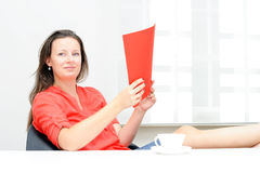 Real attractive businesswoman in her office Royalty Free Stock Image