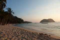 Real beach life on island of Palawan, Philippines. Sandy beach with bungalows and a boat near the island of Busuanga. Philippines Stock Image