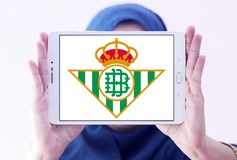 Real Betis soccer club logo. Logo of spanish soccer club Real Betis on samsung tablet holded by arab muslim woman stock photo