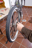 Real bicycle mechanic repairing custom fixie bike Stock Photo