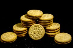 A real big stack of sweet round cookie`s. A cookie is a baked or cooked food that is small, flat and sweet. It usually contains flour, sugar and some type of oil Stock Photo