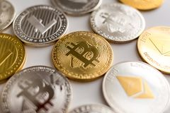 Real bitcoin litecoin and ethereum coins together royalty free stock photos