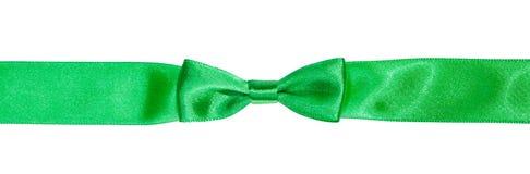 Real bow knot on narrow green satin ribbon Royalty Free Stock Photo
