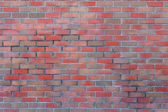 Real brick wall with different colors of stone Royalty Free Stock Image