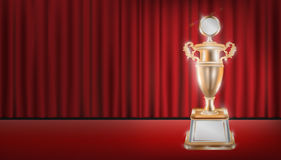 Real bronze trophy with red curtain stage background. A real bronze trophy with red curtain stage background Royalty Free Stock Photography