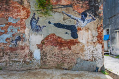 The Real Bruce Lee Would Never Do. Georgetown, Penang, Malaysia - February 19, 2015: The Real Bruce Lee Would Never Do This street art on wall by Artists for Royalty Free Stock Image