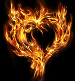 Real burning heart shape on black Stock Images