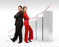 Real business people - 3d financial graph. Real business people standing in front of a 3d rendered gray financial graph with a red arrow Royalty Free Stock Photo