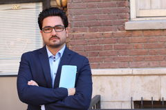 Real Business Professional Business Man Holding a Folder Wearing a Blue Shirt and Glasses. Upset and Thinking Stock Photo