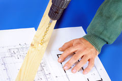 Real Carpenter drilling wood with drill machine Royalty Free Stock Photo